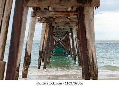 Under neith Port Noarlunga Jetty. Beams and Structures.