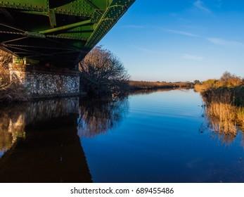 Under the railway bridge - Sunrise in the ditch Burlamacca