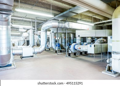 under the roof of a large building, there is a technical room with exhaust system