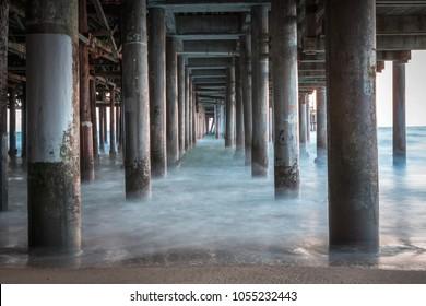 Under the Santa Monica pier long exposure ocean waves