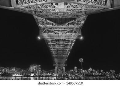 Under the Sydney Harbour Bridge at night (black and white)