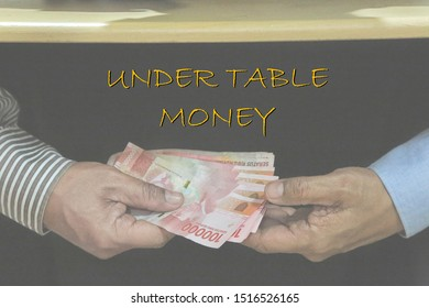 Under table money, an expression of bribery, corruption money, facilitation payments, with a background of handover money under the table