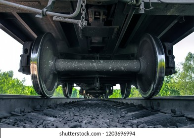 Under the train. Super wide angle, perspective lines. Railway background. Freight train, railroad theme. Transporting system, cargo service. Set of wheels. High speed train. Travel and adventures