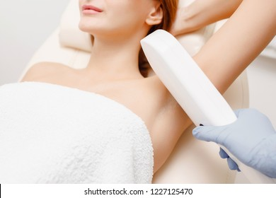 Underarm laser hair removal treatment. Body care woman.