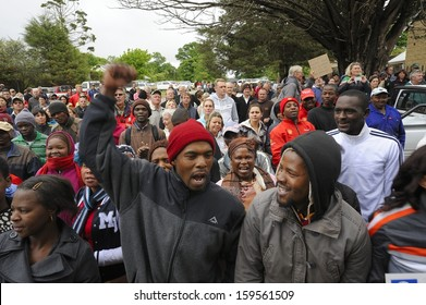 UNDERBERG, SOUTH AFRICA  OCTOBER 22: Community demonstates at Himeville Court as suspects in the macabre murder of Dan Knight are arraigned on October 22, 2013 -  Kwazulu Natal, South Africa.