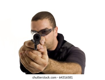 Undercover policeman with a rough look, aiming at you with a semi automatic gun