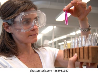 undergraduate college student examining the results of a chemistry lab experiment, in the school's lab, Brooklyn, NY, May 6, 2016