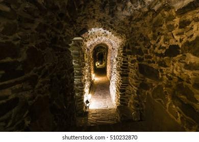 Underground corridor cave with warm orange colors and dark