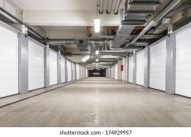 Underground European storage and parking facility with numbered bays.