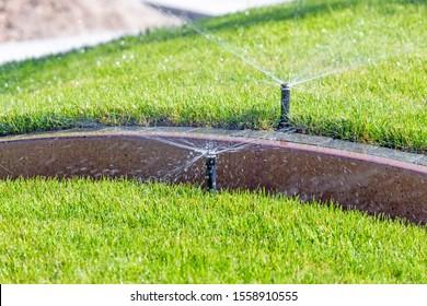 Underground irrigation sprinkler system, automatic watering park lawn.