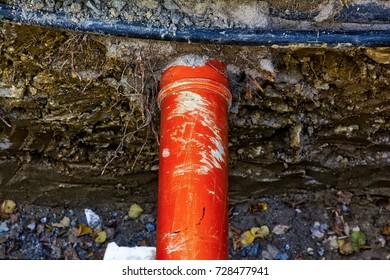 Underground Orange Pipe Construction Project Street Work
