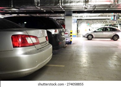 Underground parking with cars.