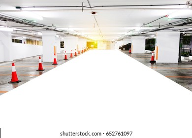 Underground parking with cars. White colors. Cars Parking garage interior, industrial building. Free parking lot of city shopping mall.