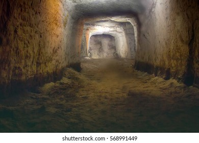 Underground passage to conquerors (subterranean attack) fugitives (deposed king) and robbers (stolen treasures). Dark cave walk under ground, in tunnel into castle