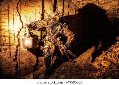 Underground post apocalyptic creature with homemade weapons and lantern