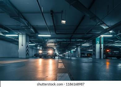 Underground public garage parking with cars, movie style toned