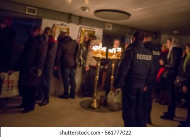 Underground religious meeting with police coming. Blurred image out of focus.