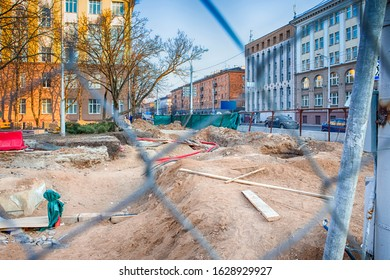 Underground Rennovation Works in City with Protective Fence Wire At Foregound. Horizontal Image