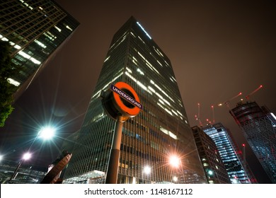 Underground sign against JP Morgan skyscraper at Canary Wharf - London,UK,1 August 2018