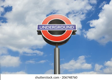Underground sign on the background of clouds in the sky