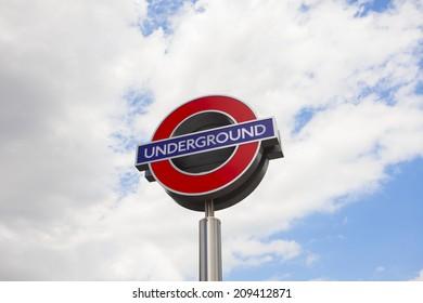 Underground sign on sky background