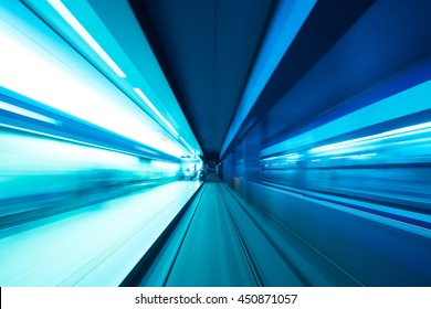 Underground subway tunnel blurred in speed motion and blue toned
