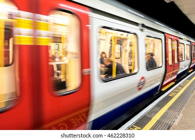 Underground Tube Station with Moving train motion blurred in London, UK
