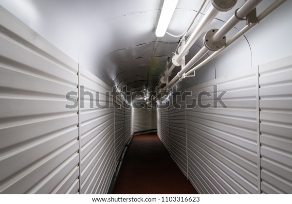 Underground walking tunnel with pipes