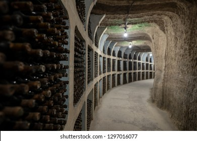 Underground wine cellar with aging wine bottles in racks