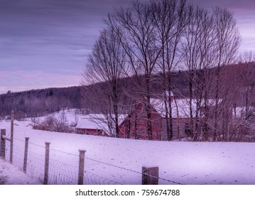 UNDERHILL, VERMONT - NOVEMBER 18, 2017: First snowfall decorates the field next to an old Vermont barn.