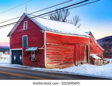 UNDERHILL, VERMONT/USA - NOVEMBER 18, 2017: An old red barn in the evening at the beginning of a Vermont winter.