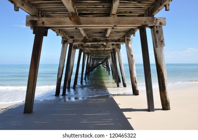 Underneath the Grange Jetty in sunny South Australia taken at noon as the morning tide subsides.