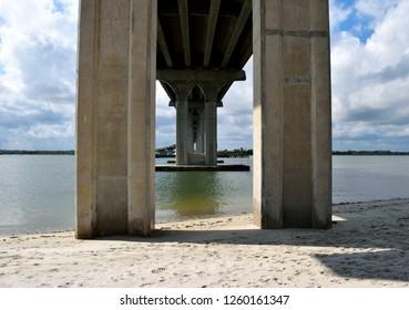 Underneath the river's bridge span