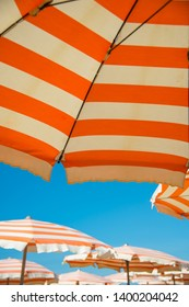 Underneath a Striped Parasol on the Beach in Viarregio