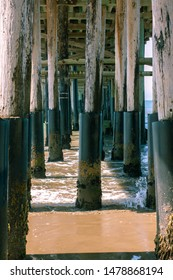 Underneath the Ventura Pier with the waves crashing
