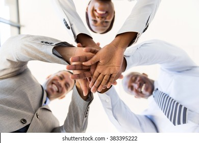underneath view of business team hands together