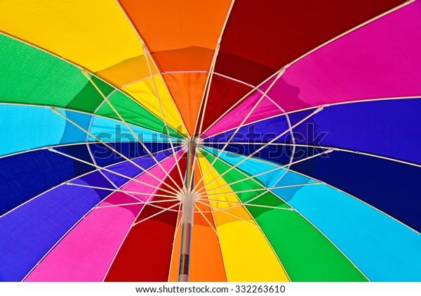 underneath-view-colorful-beach-umbrella-