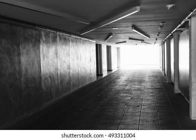 Underpass. Dark abstract underground tunnel interior with glowing end