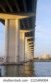 The underside of Clearwater Pass Bridge in Clearwater, Florida around sunset, an award-winning construction with twenty one spans of 120 feet each and a 74′ vertical clearance