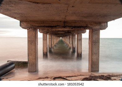 Underside of Dromana Pier on the Mornington Peninsula, south-east of Melbourne Australia.  This is a 15 second twilight exposure and the water is smooth and almost fog-like.