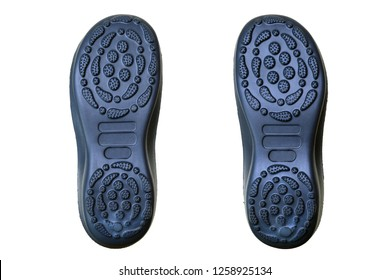 Underside of a pair of slippers, showing the tread on the sole - top view.