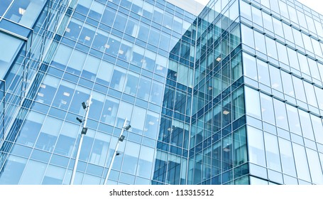 underside perspective view to steel blue glass high rise building skyscrapers, business concept of successful industrial architecture
