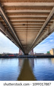 The underside view of Salford Millennium Bridge.