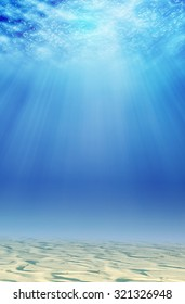 underwater background with sand and sunlight