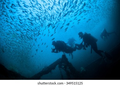 Underwater Blue Sea and scuba divers