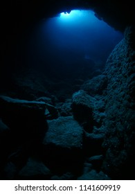 underwater cave and sun light out side beams and rays
