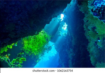 Underwater cave sunbeam landscape. Cave underwater light. Underwater sunlight