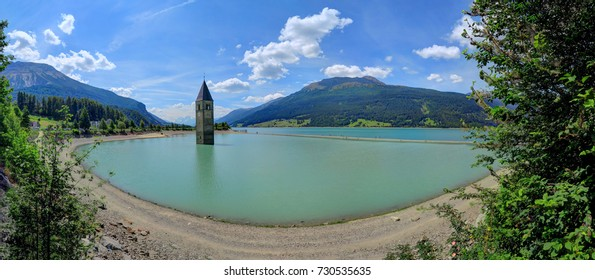Underwater church tower of an abandoned city in Reschensee Lake, Italy, in South Tyrol, Italy, near Austria and Switzerland.