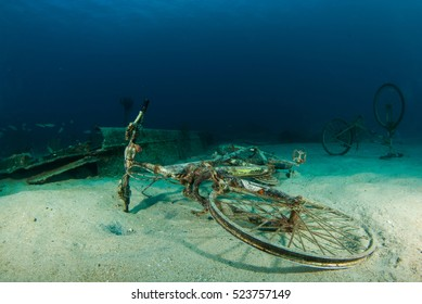 An underwater graveyard for bikes. All of these bicycles are rusting away into the ocean. Shot in the Caribbean by a scuba diver