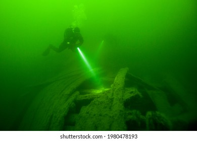 Underwater landscapes in the green waters of the Baltic Sea.